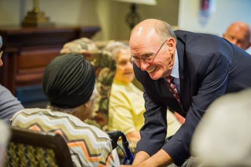 After worship services in the Bethany memory care unit, retired United Methodist Bishop Kenneth Carder goes around the room, greeting each resident by name. Carder is serving as interim chaplain at Bethany, part of the Heritage at Lowman senior community near Columbia, S.C.