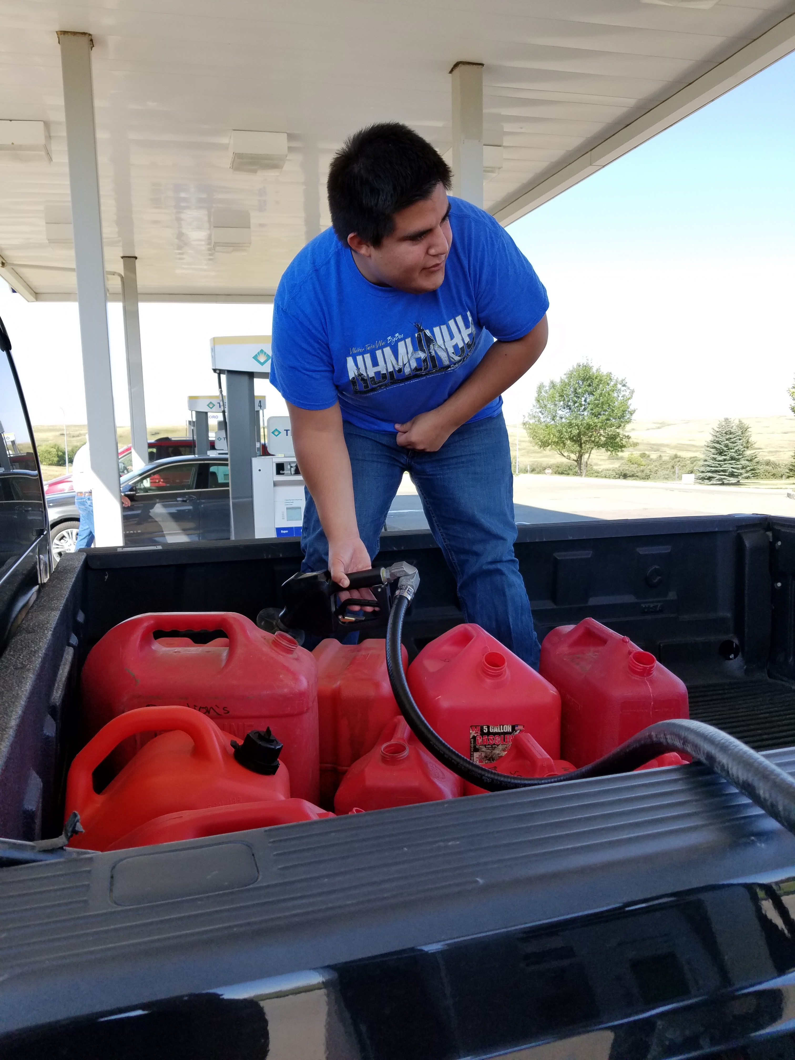 Dallas Parker, member of the Oklahoma Indian Missionary Conference, fills gas containers to run the generators at the Dakota Access Pipeline protest site where hundreds of people have gathered in support of the Standing Rock Sioux Tribe. Photo courtesy of Dallas Parker, Oklahoma Indian Missionary Conference