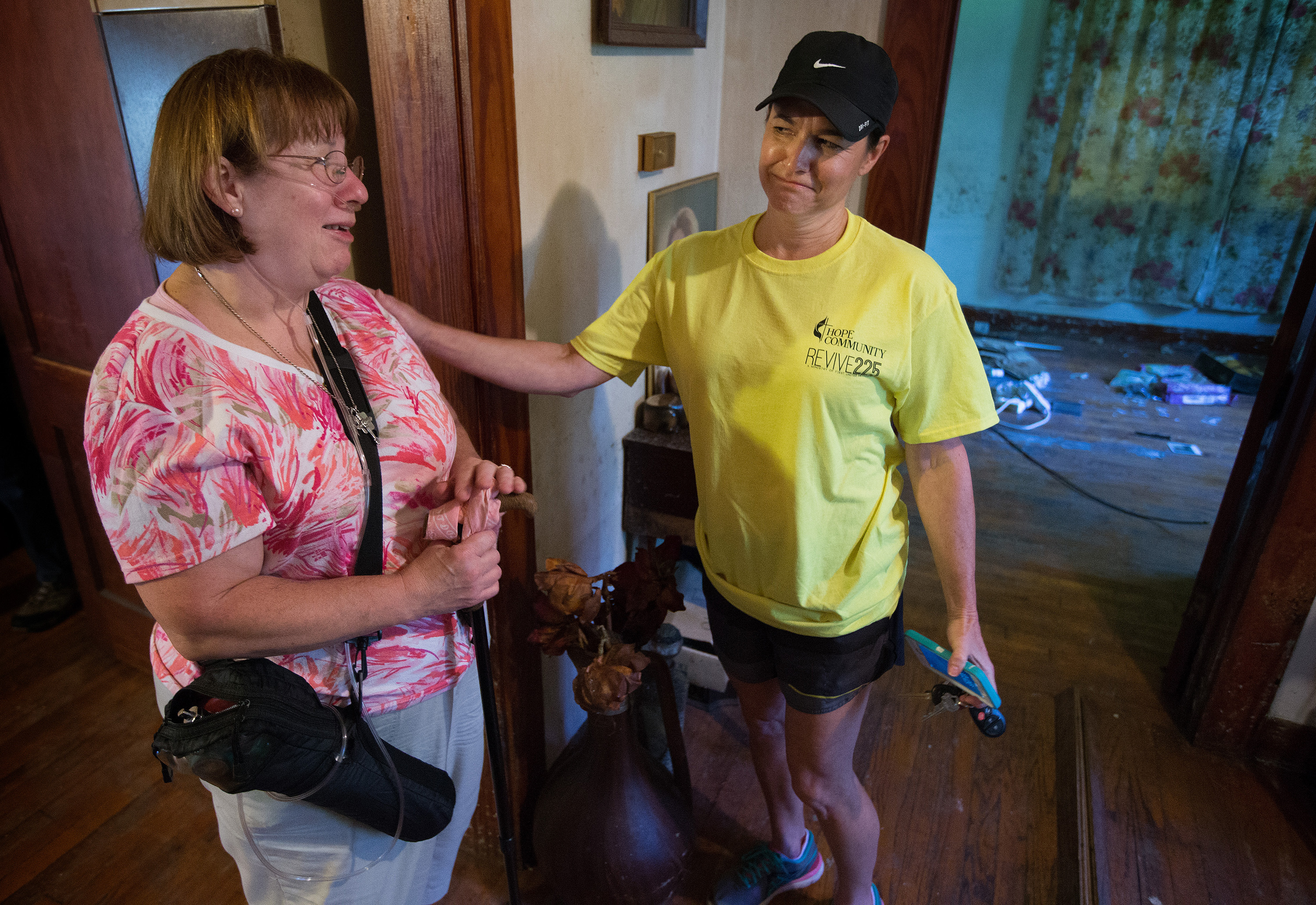 Janet Schilling (left) visits with volunteer Joni Rigby at a rental home that her family owns in Baton Rouge, La. The home was heavily damaged by flooding in the neighborhood where Schilling grew up. Rigby was part of a volunteer team from First United Methodist Church in Baton Rouge. Photo by Mike DuBose, UMNS