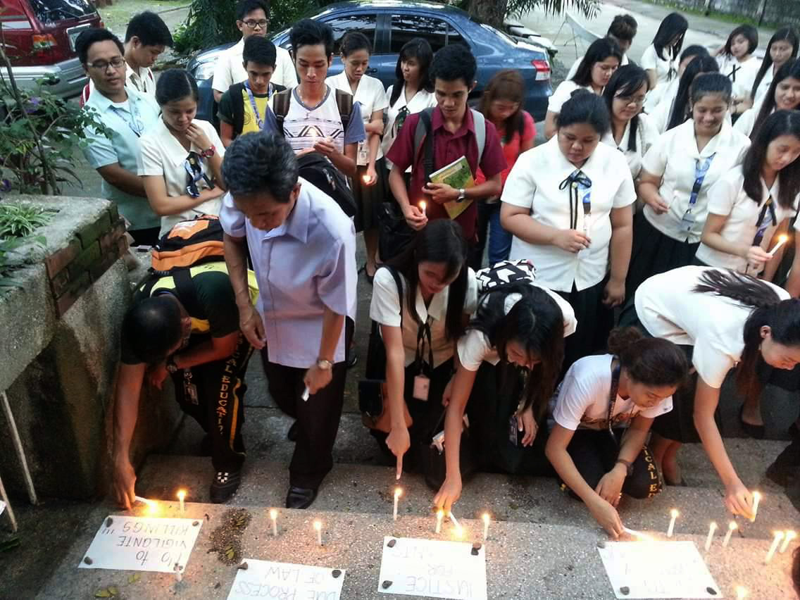 Students and some teachers from the College of Education in Wesleyan University-Philippines in Cabanatuan City at an Aug. 31 candle lighting and prayer gathering, calling for an end to killings related to the government's war on drugs. Photo courtesy of Bernard Cortez