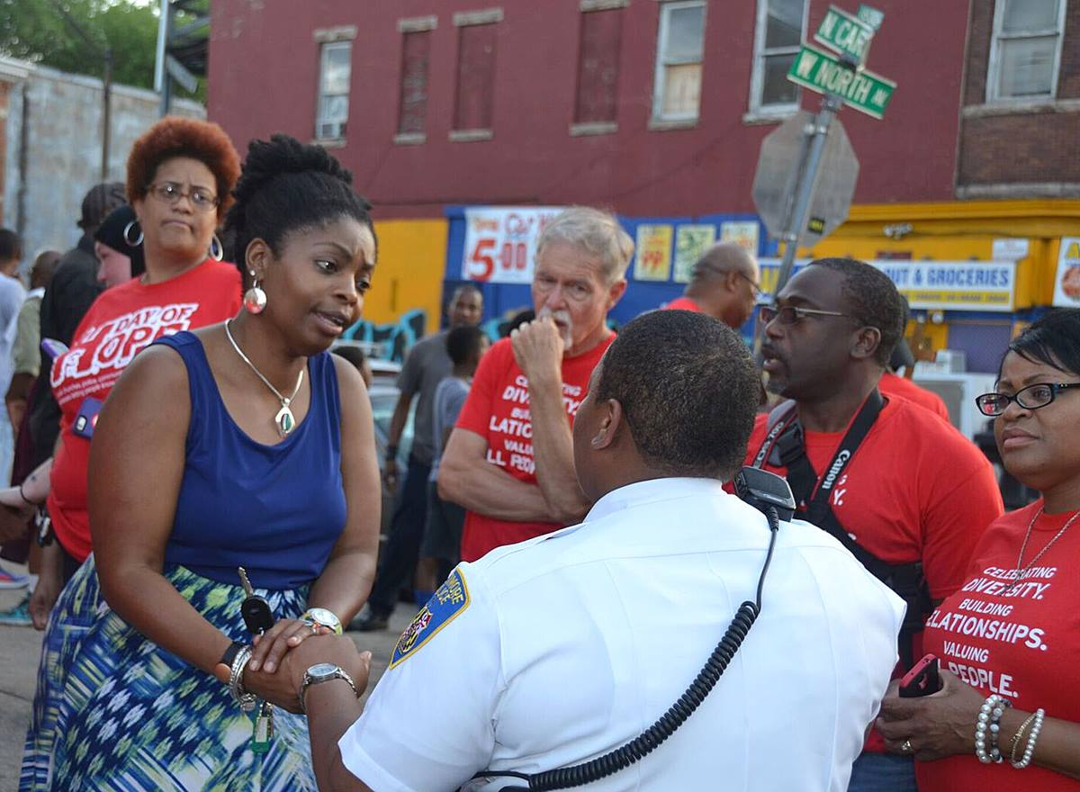 During a prayer walk in Baltimore following days of unrest, the Rev. Cynthia Moore-Koikoi thanks a Baltimore police officer for her service. Moore-Koikoi was elected bishop in July. Photo by Sheila George.