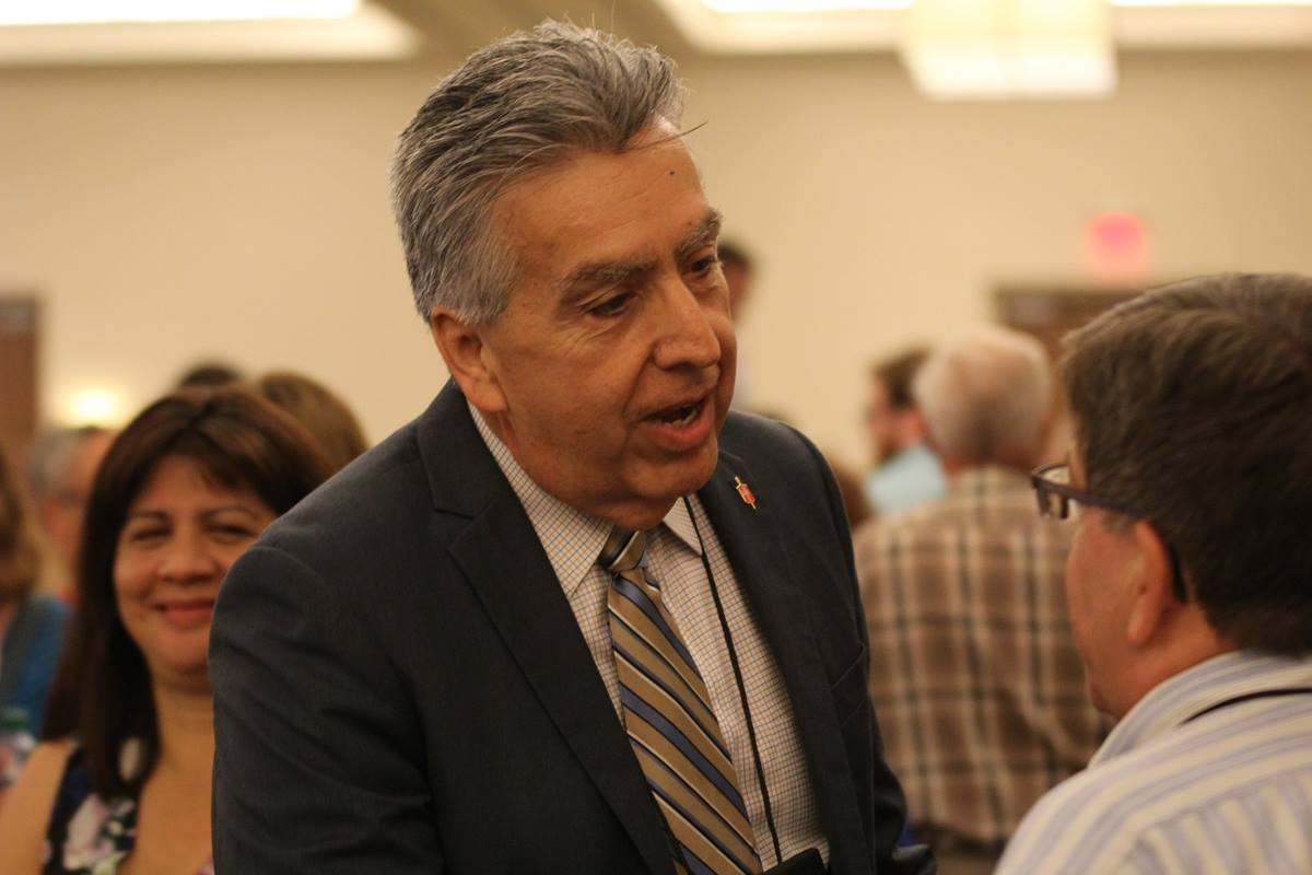 Bishop Ruben Saenz Jr. mingles with Great Plains Conference delegates and others at the South Central Jurisdictional Conference in Wichita, Kan., where he was elected to the episcopacy on July 14. Saenz was assigned to lead Great Plains. Photo by Eugenio Hernandez.