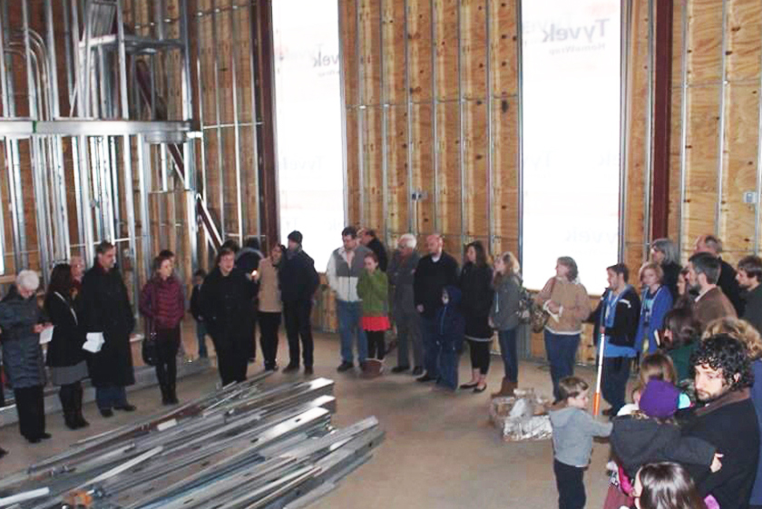 Oconee Street church members gather before drywall is added to cover the sanctuary structure in prayer. Photo courtesy of the Rev. Lisa Caine