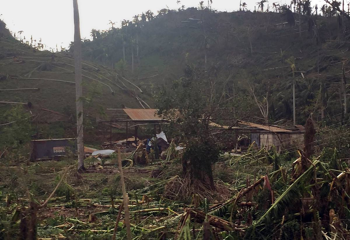Methodist Bishop Ricardo Pereira Diaz and other Methodist pastors were some of the first people to reach Baracoa, Cuba, on Oct. 6, to bring emergency supplies for church members and neighbors affected by Hurricane Matthew.