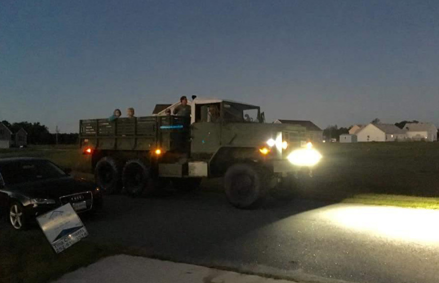 The Rev. Bruce Willis, McBride United Methodist Church, loaded up a six-wheel drive military vehicle and drove into flood waters to deliver water and food and prayers to trapped residents.