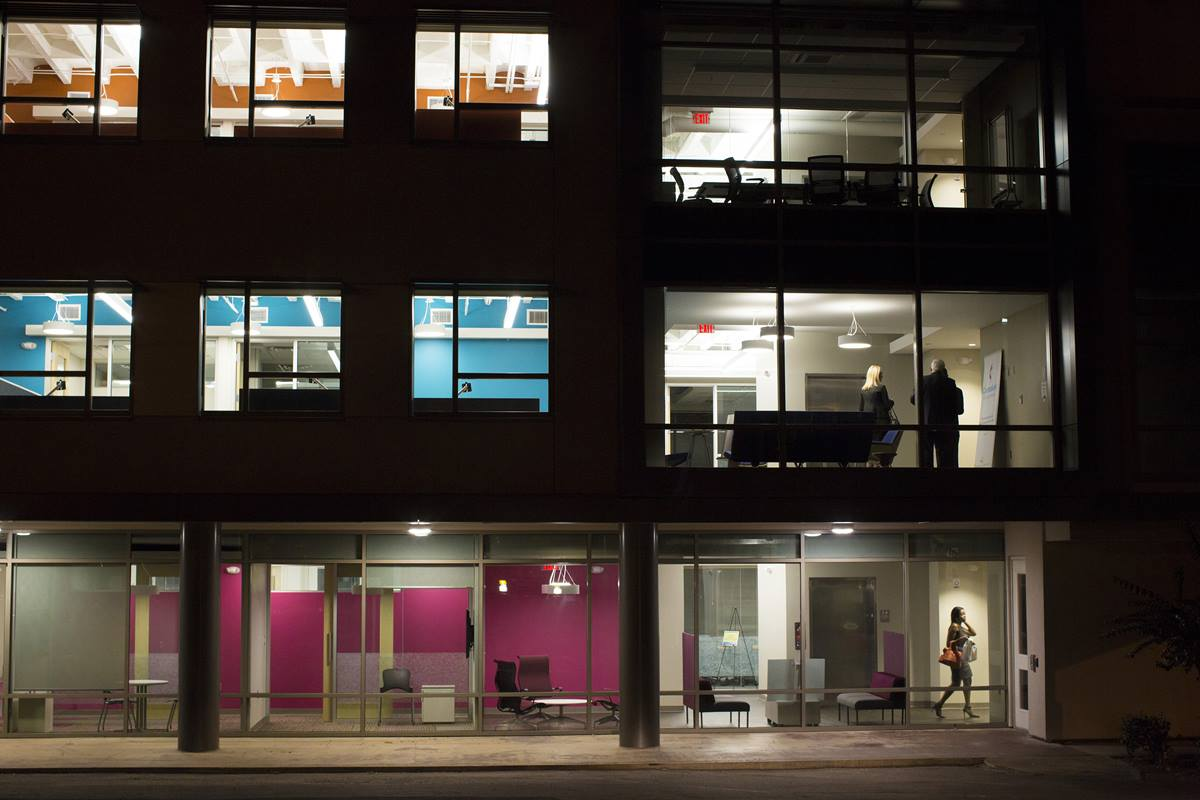 A night photo of the new offices at Global Ministries in Atlanta show off its colorful open floor plan.