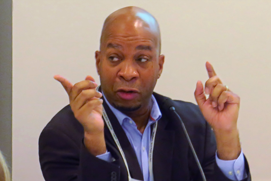 The Rev. Cedric Johnson, assistant professor of pastoral theology and congregational care at Wesley Theological Seminary, was among the panelists at the Nov. 14-16 Faith and Guns Forum, held in Washington by the United Methodist Board of Church and Society. Photo by Sam Hodges, UMNS.