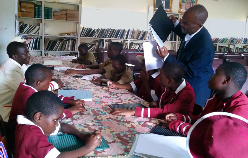 Daniel Chiomba and the visually impaired pupils at Murewa Central Primary School. Photo by Eveline Chikwanah, UMNS.