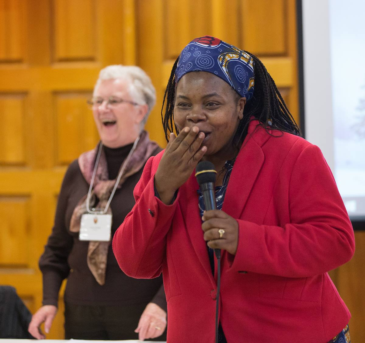 The Rev. Tazvionepi Nyarota (right) ululates to express her appreciation of a decision by  the Edmonton Presbytery, a governing body in the United Church of Canada, to support the Zimbabwe United Methodist Church in Canada as a mission of the United Church. The meeting was held at McDougall United Church in Edmonton, Alberta. Photo by Mike DuBose, UMNS.
