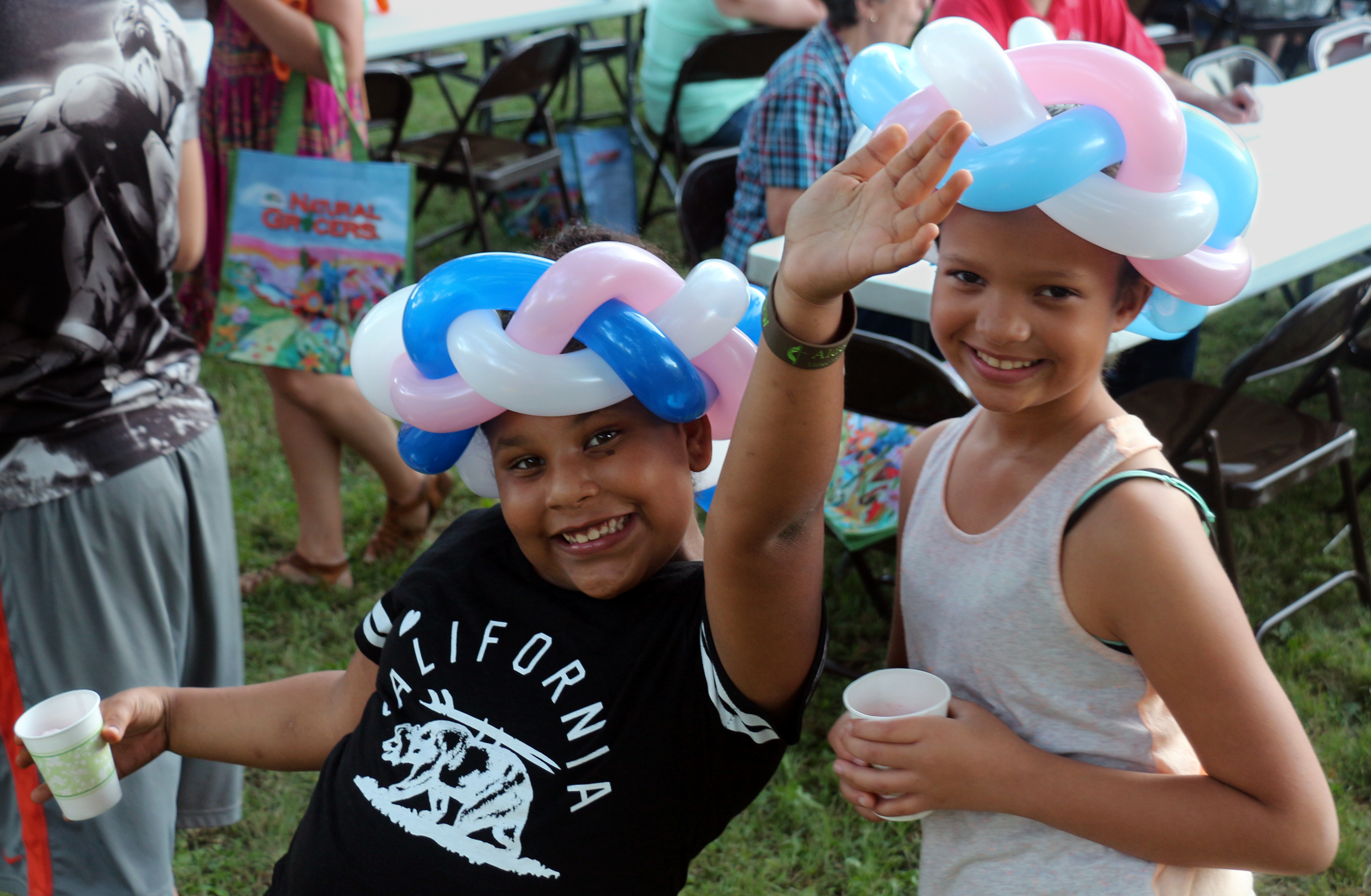 Children at Aldersgate United Methodist Church enjoy their balloon animal hats. Photo by David Burke