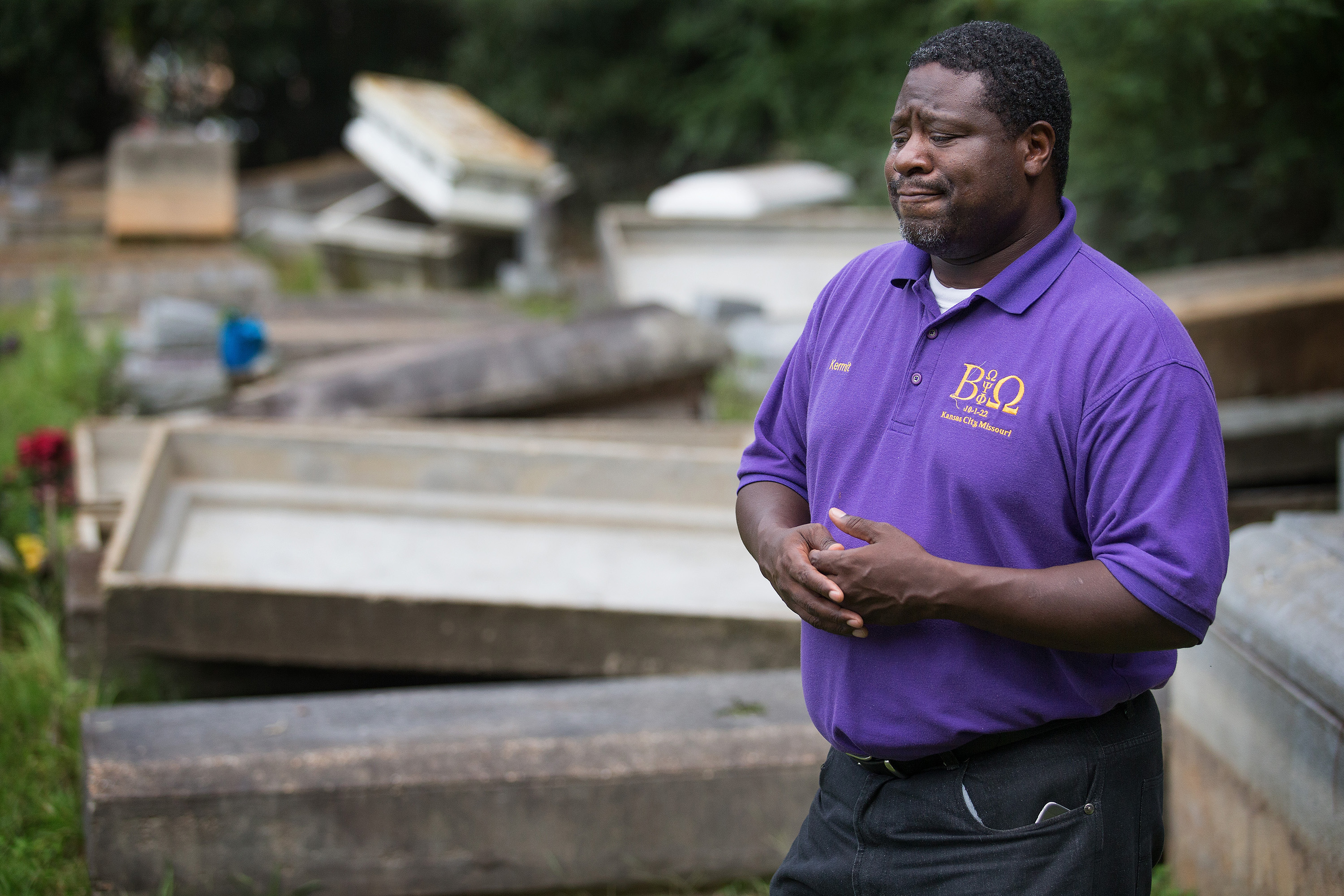 The Rev. Kermit Roberson surveys flood damage at Roberts United Methodist Church's Plainview Cemetery in Denham Springs, La., where floodwaters lifted many caskets out of their concrete burial vaults. Photo by Mike DuBose, UMNS.