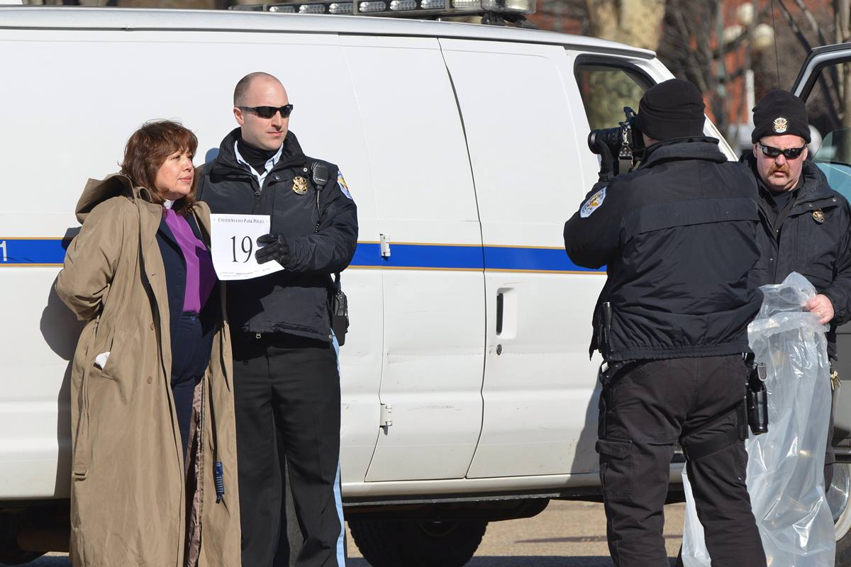 Police arrest United Methodist Bishop Minerva Carcaño after a prayer vigil on Feb. 17, 2014, at the White House in support of progress on immigration reform and an end to deportations.