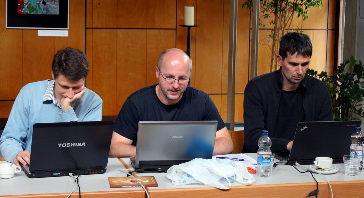Zoltán Kovács (left) of Hungary, Filip Gärtner (center) and Ctirad Hruby, both from the Czech Republic, work on laptops during a seminar of the of the Methodist e-Academy that includes presentations from students and lectures by teachers. The e-Academy  is helping with a new online library of Methodist and Wesleyan resources. Photo by Bernfried Schnell, UMNS