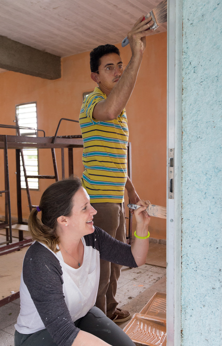 Melody Davis (foreground) and Luís Francisco Bravo Olazabal help paint a dormitory at Camp Canaan, a Methodist retreat center near Santa Clara, Cuba. Photo by Mike DuBose, UMNS.
