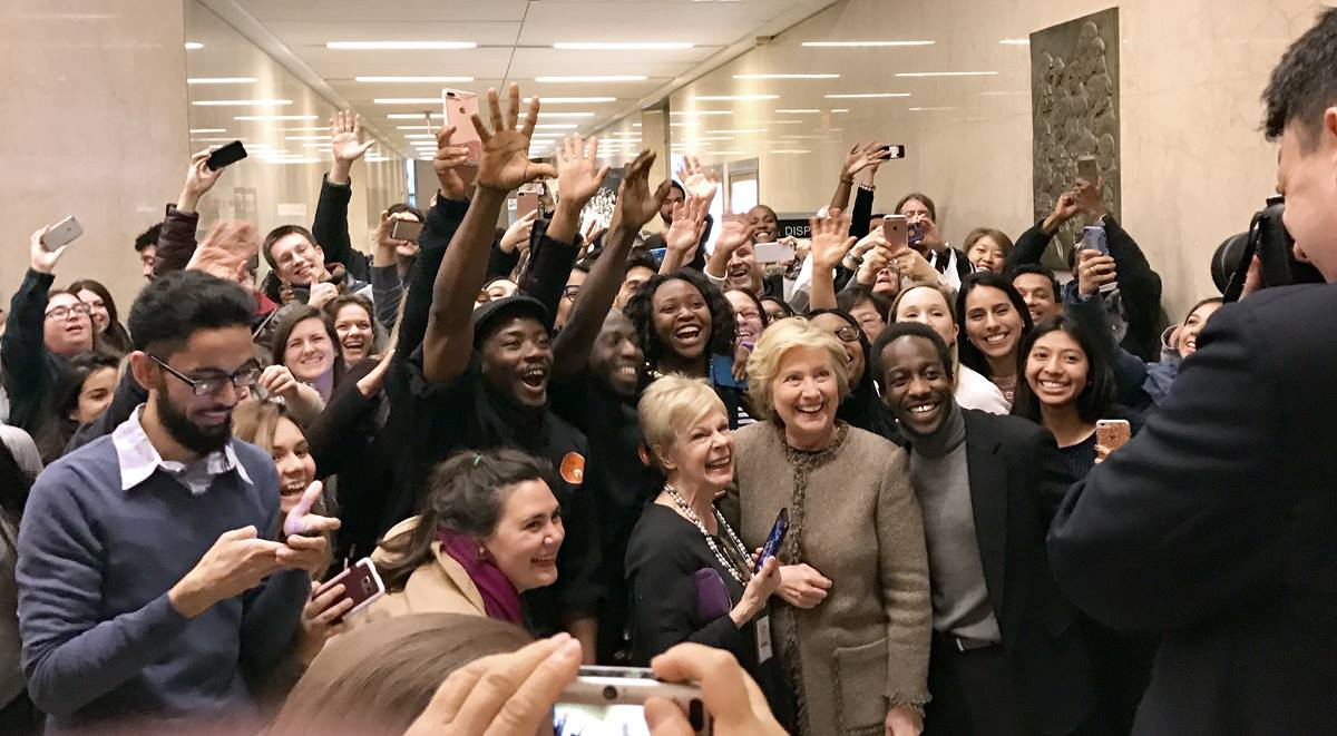Hillary Clinton stops for photos with a group of well-wishers who had gathered outside a room off the lobby of the Interchurch Center in New York, where Clinton attended a Jan. 31 lunch. Photo by Danyelle Ditmer