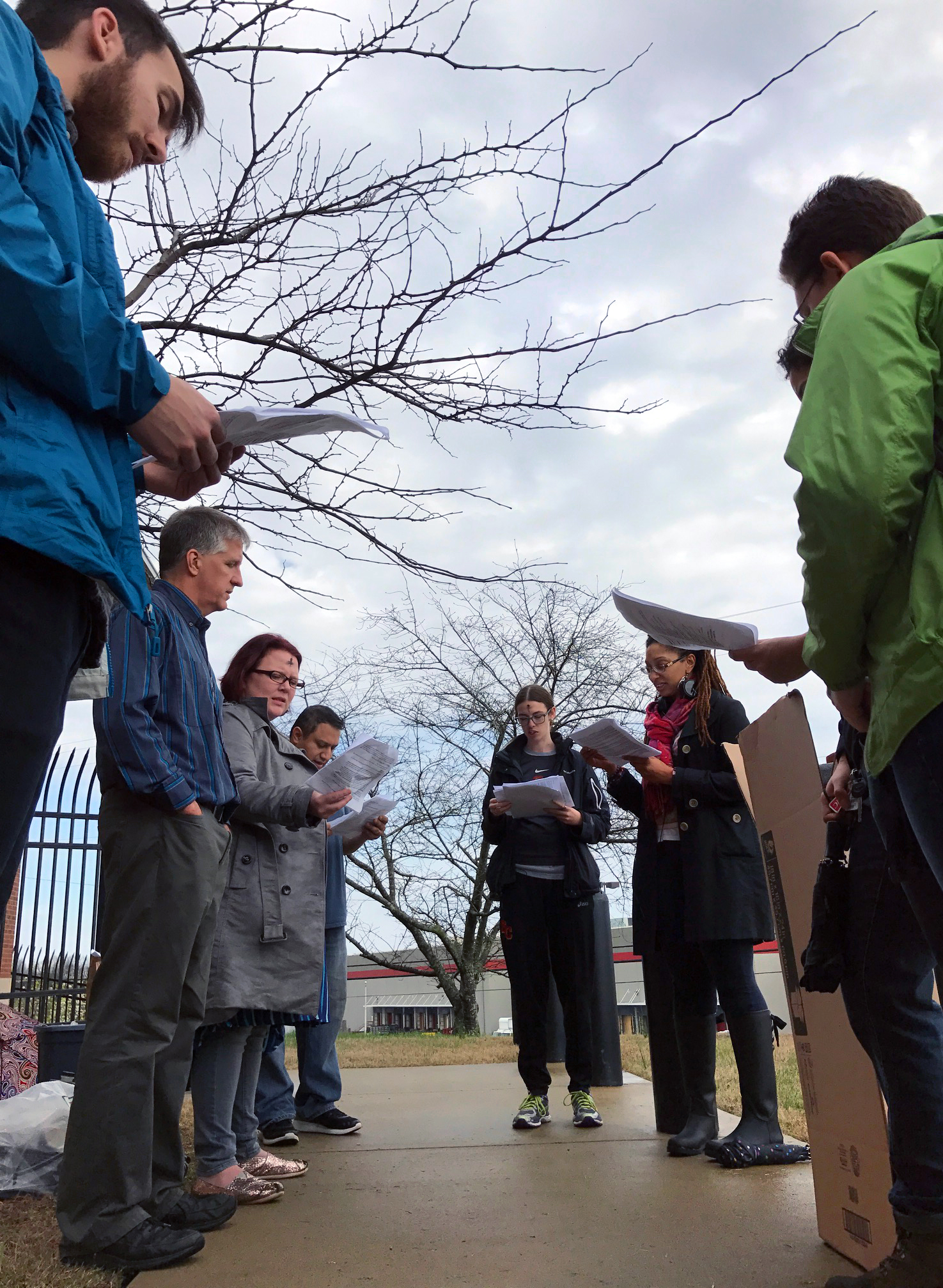 Clergy and laypeople from several denominations who are members of the Nashville Community Defense held a prayer vigil in front of the local Immigration and Customs Enforcement agency March1. Photo by Sophia K. R. Agtarap, UMNS.