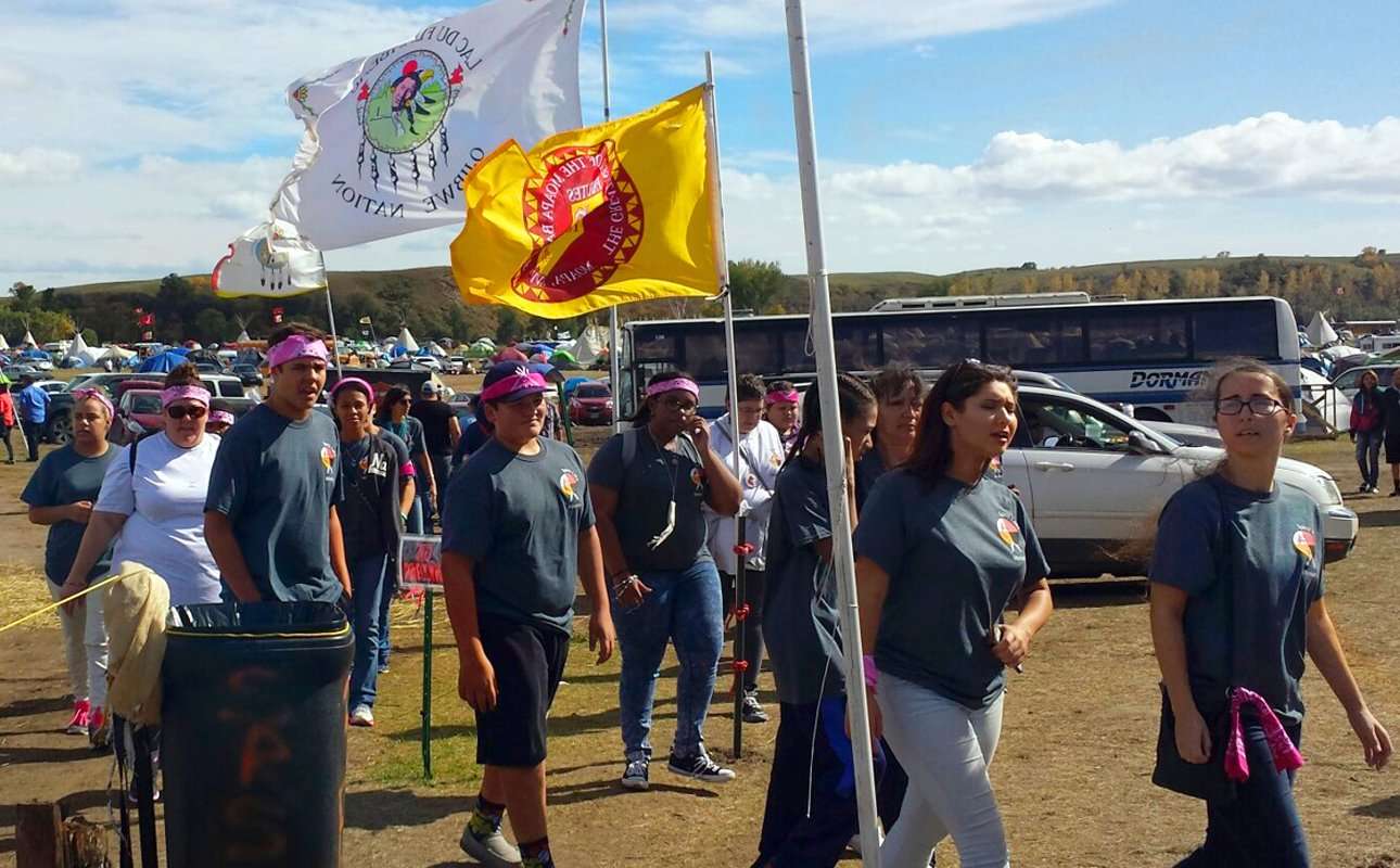 Youth, chaperones and organizers of the Peg-Leg Flamingos conference take in the views during a visit to Standing Rock in North Dakota in September. Photo courtesy of the Rev. Carol Lakota Eastin.