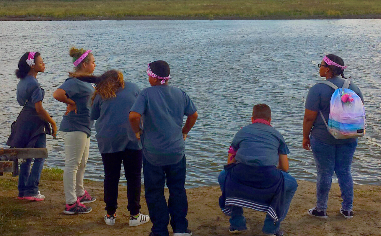 Students from Peg-Leg Flamingos, the Native American International Caucus' youth leadership training program, gather to pray for the water during their visit to the Standing Rock Sioux campsite near Cannon Ball, North Dakota, in September. Photo courtesy of the Rev. Carol Lakota Eastin.