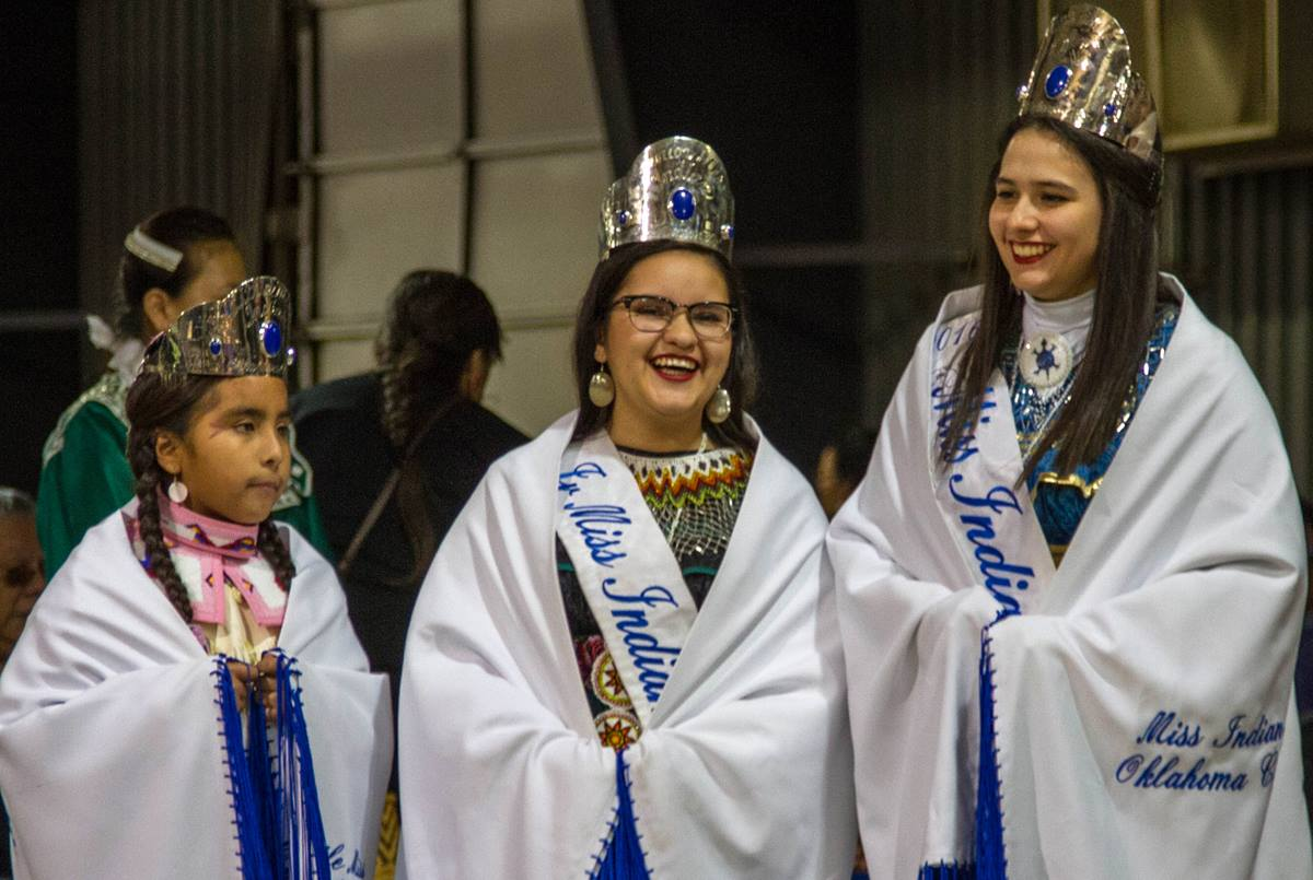 Madeleine Freeman, 2016 Miss Indian Oklahoma City Princess, right, prepares to dance with the 2016 Junior Miss Indian Oklahoma City Princess, Jessica J. Meikle, center, and the 2016 Little Miss Indian Oklahoma City Princess, Victoria Echiwardy, during a pow-wow in Shawnee, Okla., in their honor. Photo by Ginny Underwood, UMNS.