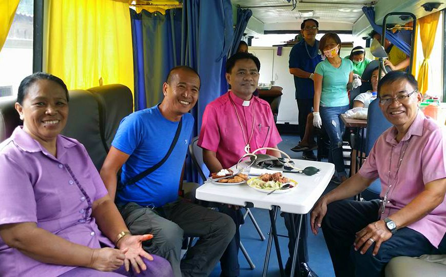 """A new mobile bus clinic was donated to help United Methodists reach """"more patients in far-flung areas,"""" said Bishop Rodolfo Juan, pictured third from left. The mobile bus clinic was donated by Riza Angara-Moises of the Genesis Transport Service, Inc., through Homer Garong, a United Methodist lawyer.  Photo courtesy of Bishop Rodolfo Juan."""