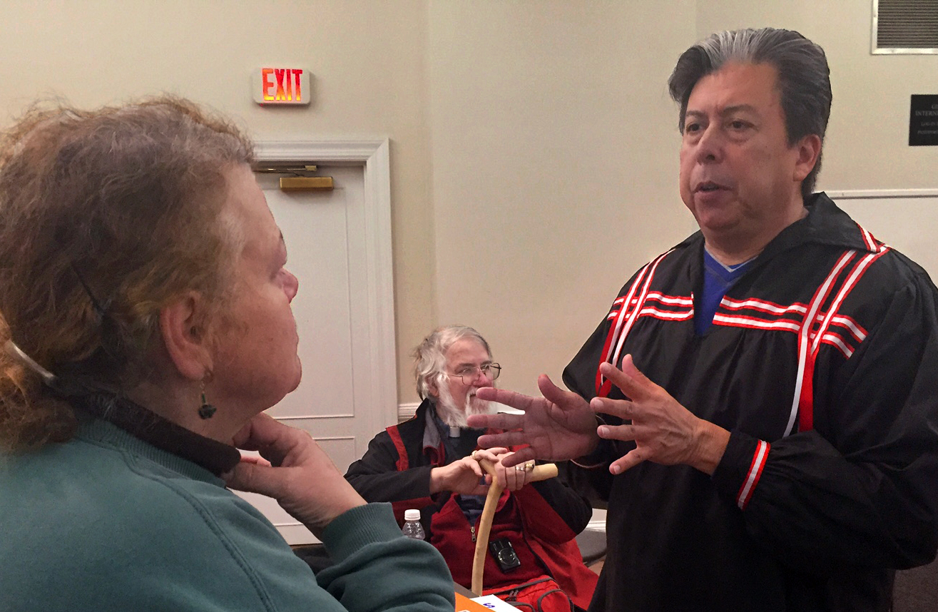 The Rev. David Wilson, superintendent of the Oklahoma Indian Missionary Conference, greets participants at the Methodist Building before the march. The conference has been working with protestors since last August, providing support during the nearly year-long encampment with supplies and money. Photo by Erik Alsgaard, UMNS.