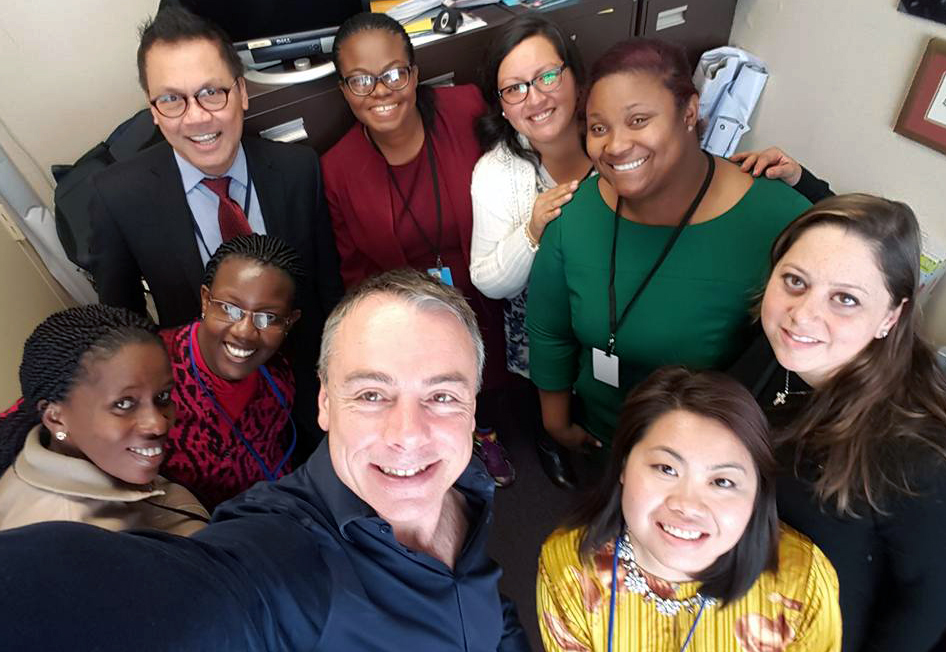 """Luciano Kovacs, regional secretary for the World Student Christian Federation-North America, takes a selfie with some of the federation's delegation to the 2017 U.N. Commission on the Status of Women. At upper left is the Rev. Liberato """"Levi"""" Bautista of the United Methodist Board of Church and Society, a """"senior friend"""" of the organization. Photo by Luciano Kovacs."""