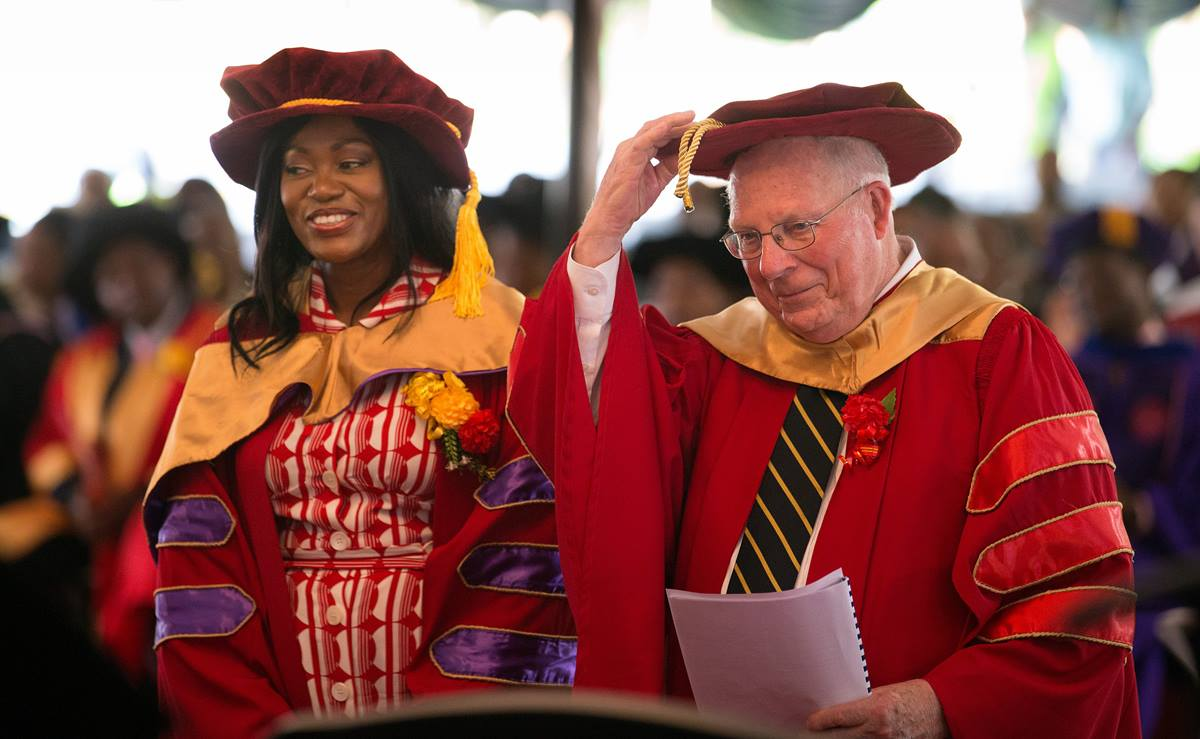The Rev. James Waits (right) and Tsitsi Masiyiwa receive honorary doctorate degrees during the 25th anniversary celebration for Africa University in Mutare, Zimbabwe. Waits, who serves a professor emeritus of practical theology at Candler School of Theology, has a long history of civil rights activism in Mississippi. Masiyiwa and her husband are founders of run the Higherlife Foundation, a non-profit that provides access to education for African students. Photo by Mike DuBose, UMNS
