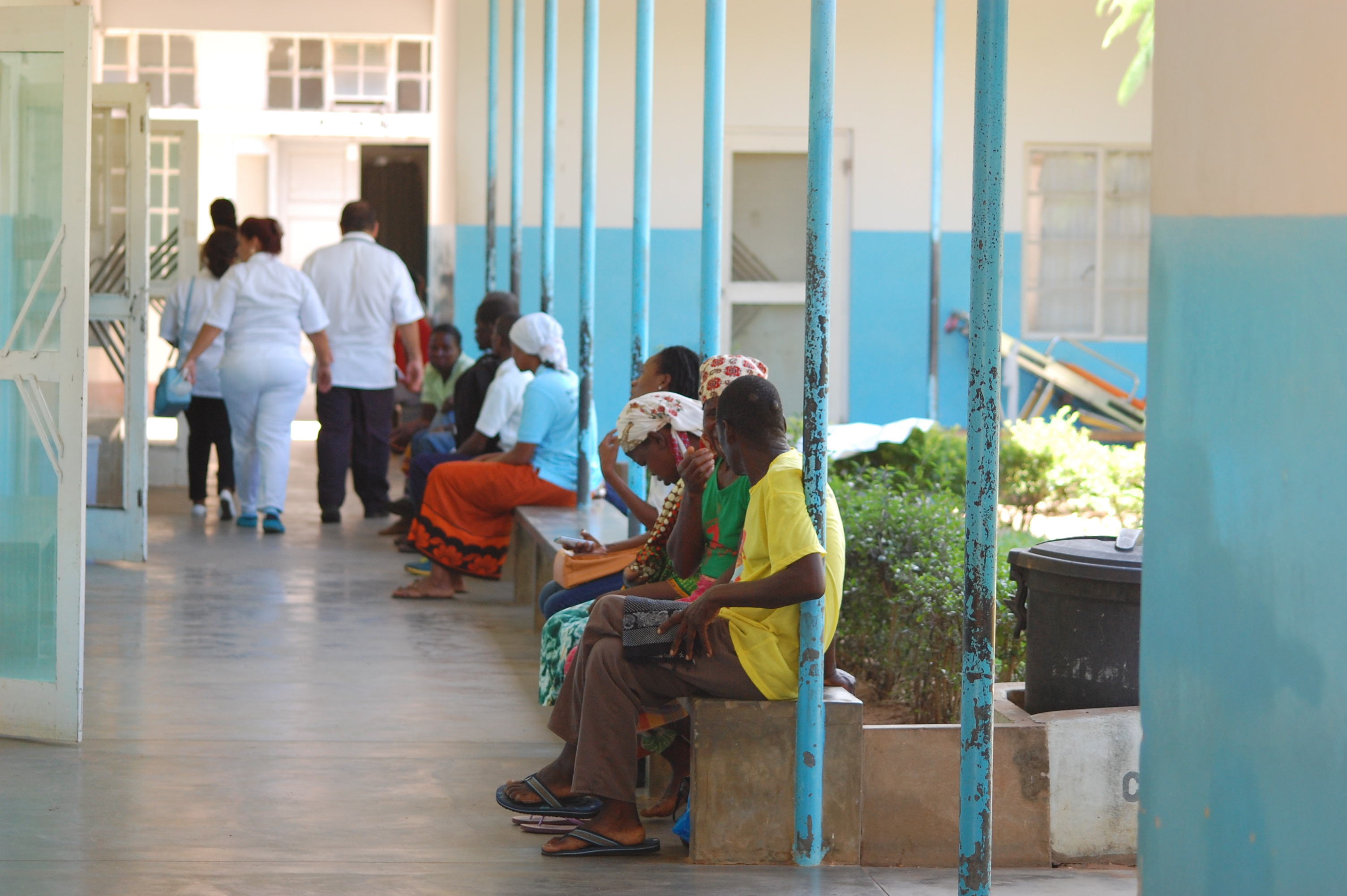 Men and women sit outside the maternity ward of the Chicuque Rural Hospital in Chicuque, Mozambique. Photo by Keeton Bigham-Tsai, Connectional Table.