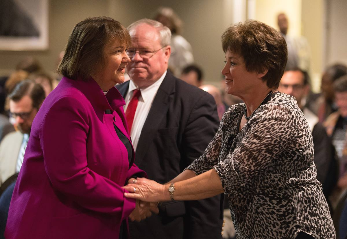 Bishop Karen Oliveto (left) meets Dixie Brewster (right) for the first time prior to the opening of oral arguments before the United Methodist Judicial Council meeting in Newark, N.J. Brewster is petitioner questioning whether a gay pastor can serve as a bishop in The United Methodist Church. At rear is the Rev. Keith Boyette, representing Brewster before the council. Photo by Mike DuBose, UMNS.
