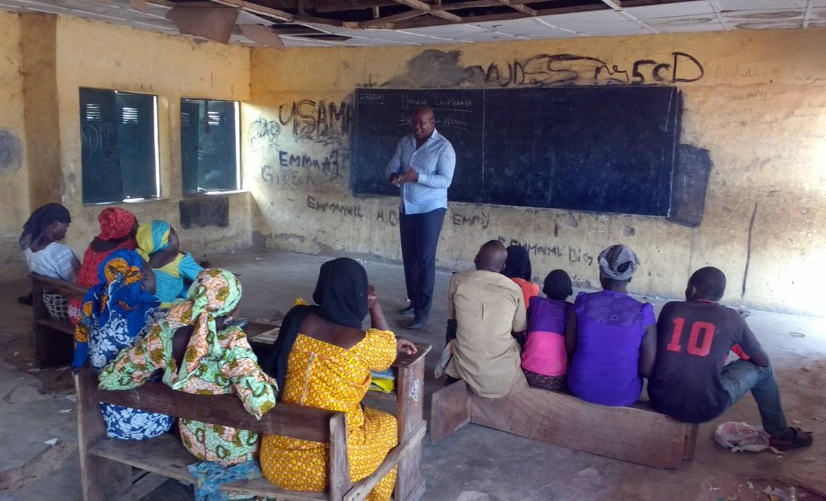 The head teacher of McBride Literacy School in Jalingo, Nigeria, ThankGod Heman, teaches a Hausa language class for beginners; the other main class is a three-year advanced English course. The goal of the school, which is operated through the church, is to improve the education level of people who can neither read nor write so they can speak, write, read and understand the Bible. Photo by Sharon Adamu Bambuka, UMNS.