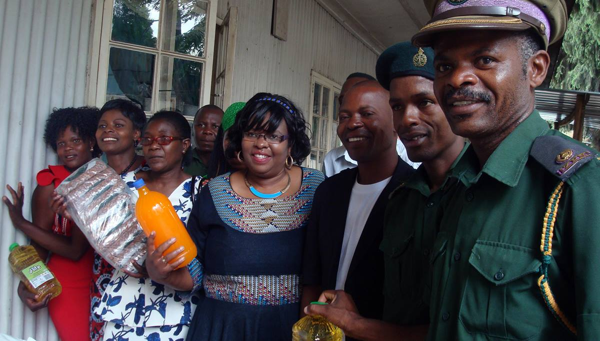 "Zivorinashe Mujaji, center in navy dress, United Methodist Board of Church and Society chairperson for the Harare East District in Zimbabwe, said they were ""disturbed"" by the food situation in most prisons around the country. Along with the Prison Fellowship Zimbabwe, they are responding to challenges faced by the Zimbabwe Prisons and Correctional Services in feeding inmates. Photo by Kudzai Chingwe, UMNS."