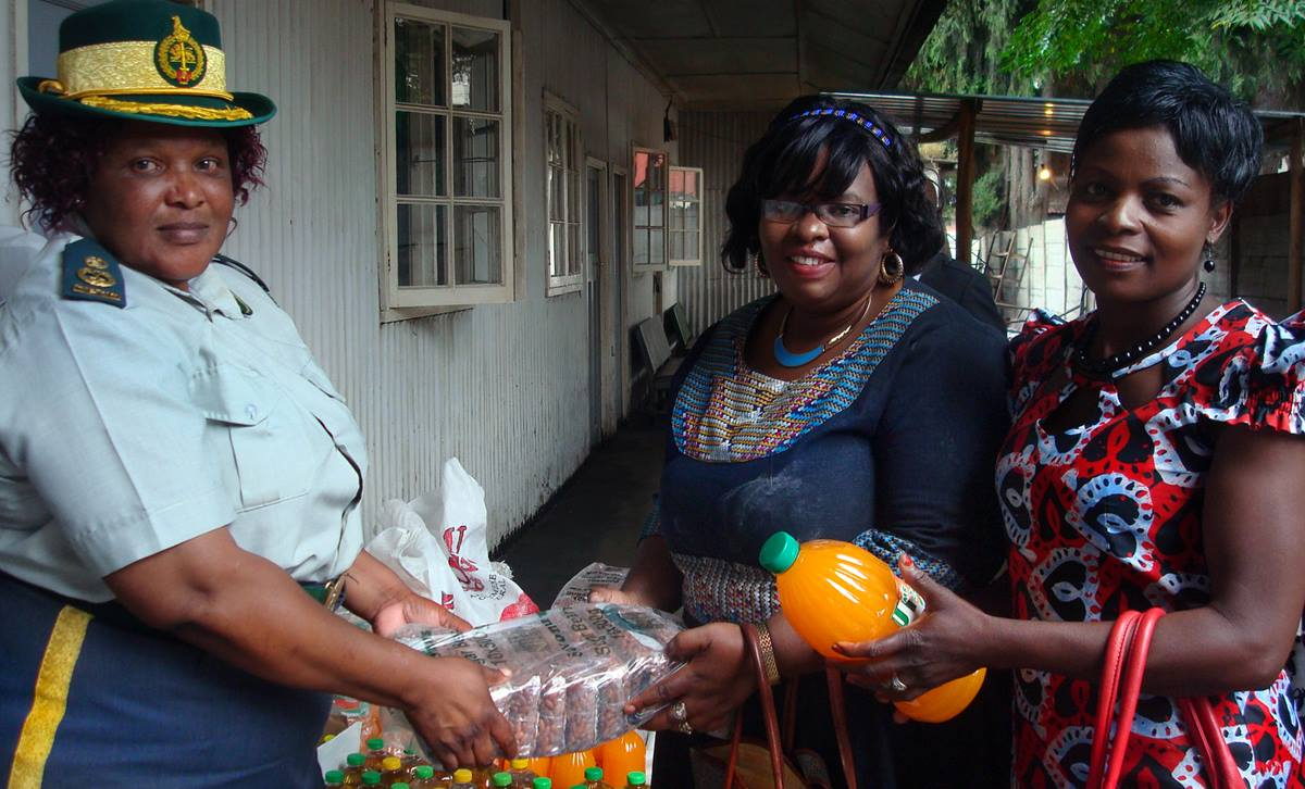 Harare Metropolitan Province assistant commissioner Elizabeth Banda Karinda, left, accepts donations from Zivorinashe Mujaji and Tarisai Mufambi of the United Methodist Board of Church and Society for the Harare East District. The United Methodist Church of Zimbabwe donated more than $1,300 worth of food to female inmates at Chikurubi Prison. Photo by Kudzai Chingwe, UMNS.