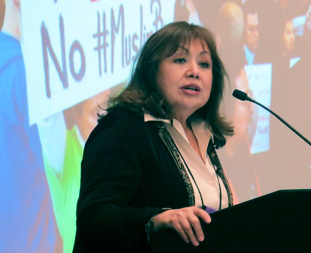 Bishop Minerva Carcaño speaks to the Council of Bishops on May 4 in Dallas, urging support for immigration initiatives. Photo by Sam Hodges, UMNS