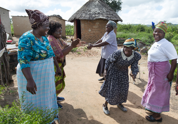 Margaret Tagwira (second from left) has a joyful reunion with women who are growing the chaya plant in Chivi, Zimbabwe. From left are: Sarudzai Mkachana, Tagwira, Regina Mavuko, Sylivia Shuro Kamurai and Modesta Manzungo. Photo by Mike DuBose, UMNS.