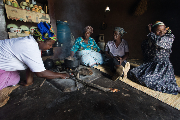 Chaya farmers roast peanuts and corn for a snack as they gather to discuss the challenges of introducing the new plant, native to South America, in Chivi, Zimbabwe. From left are:  Modesta Manzungo, Sarudzai Mkachana, Regina Mavuko and Sylivia Shuro Kamurai. Photo by Mike DuBose, UMNS.