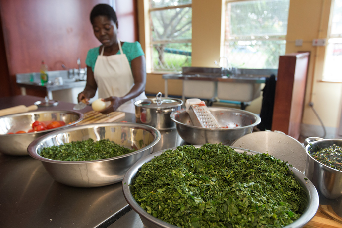 Charity Munyama prepares chaya recipes in a test kitchen at the Africa University School of Agriculture in Mutare, Zimbabwe. Photo by Mike DuBose, UMNS.