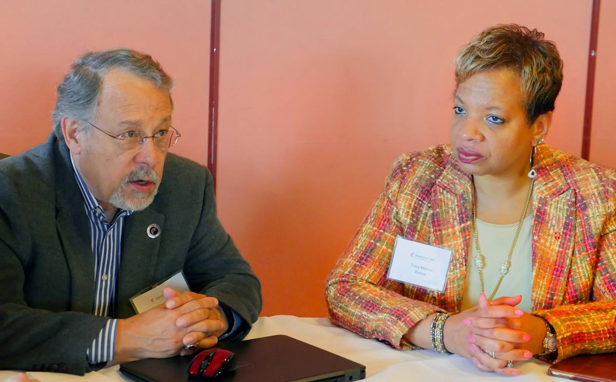 Gil Hanke, top executive of the Commission on United Methodist Men, and Bishop Tracy Malone, president of the Commission on the Status and Role of Women, join in a small-group discussion during the Connectional Table meeting in Oslo, Norway. Photo by Heather Hahn, UMNS.