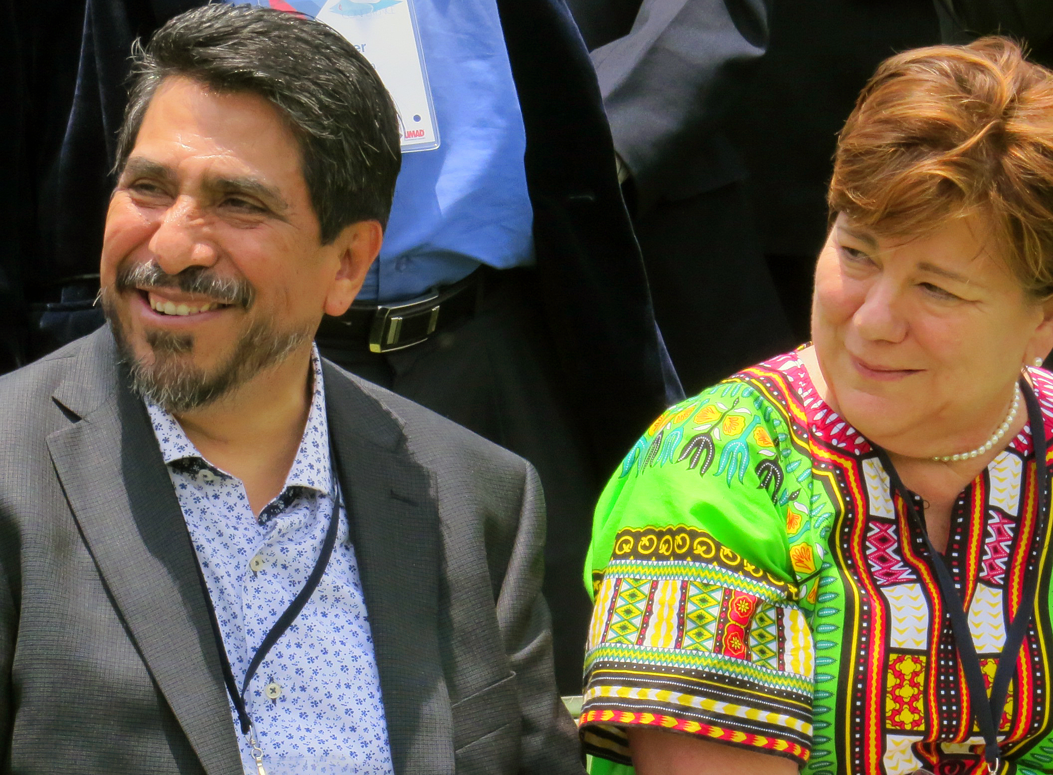 Job Cesar Romero, president of Universidad Madera, and the Rev. Kim Cape, top executive of the United Methodist Board of Higher Education and Ministry, visit before a May 28 group photo shot at the International Association of Methodist-related Schools, Colleges and Universities conference in Puebla, Mexico. Universidad Madero, a Methodist school, is hosting the event. Photo by Sam Hodges, UMNS.