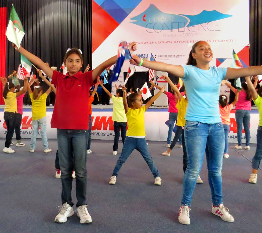 """Students at a Methodist school in Puebla, Mexico, danced at the May 28 opening ceremony of the International Association of Methodist-related Schools, Conferences and Universities (IAMSCU) conference. The conference's theme is """"Tearing Down Walls: a Pathway to Peace, Healing and Humanity,"""" and the students danced on that theme. Photo by Sam Hodges, UMNS."""