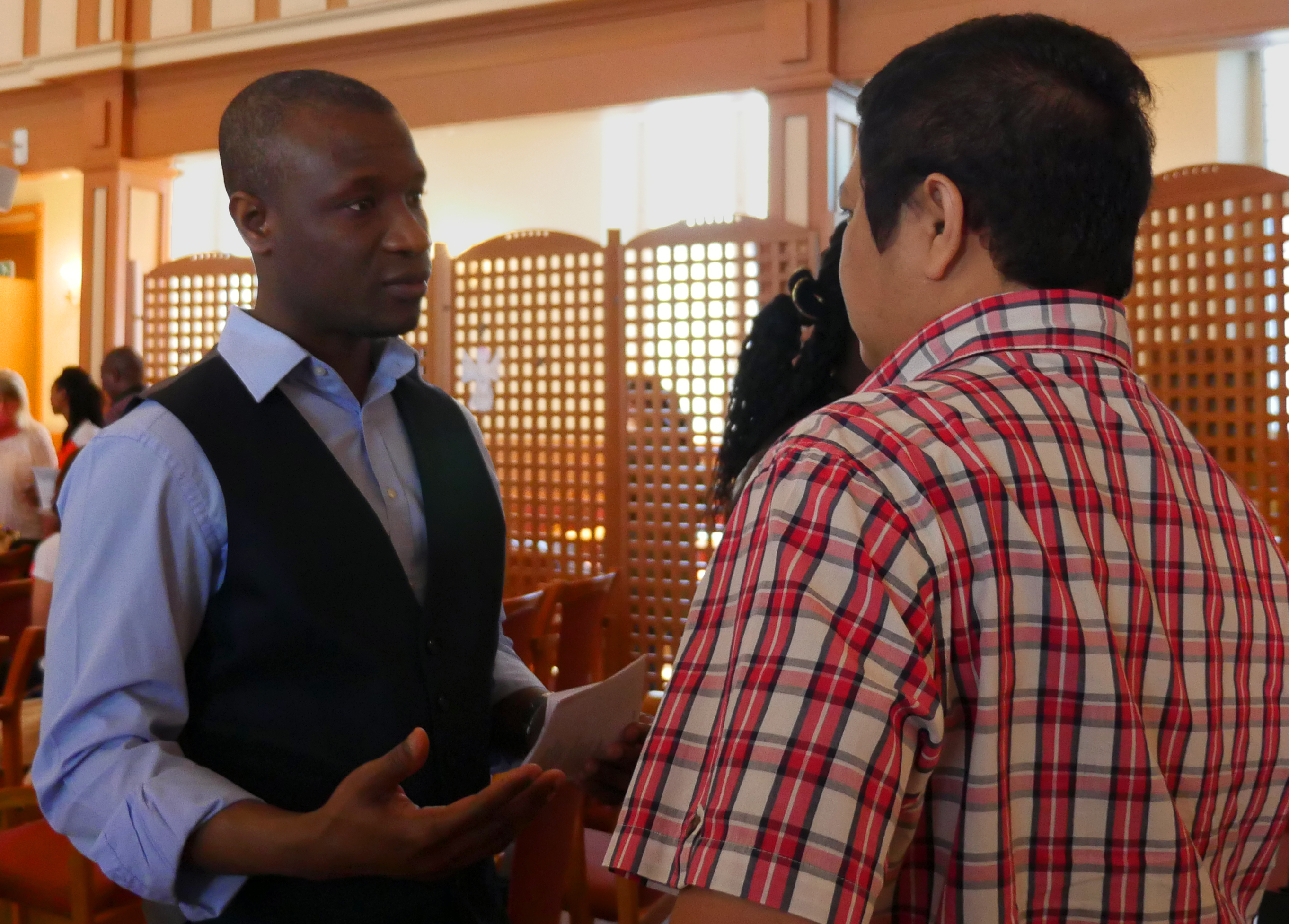 Victor Sekyere, one of the earliest members of International Methodist Church Oslo, talks to a fellow parishioner after worship. Sekyere, originally from Ghana, will be commissioned in June as a provisional elder in the Norway Annual Conference. Photo by Heather Hahn, UMNS