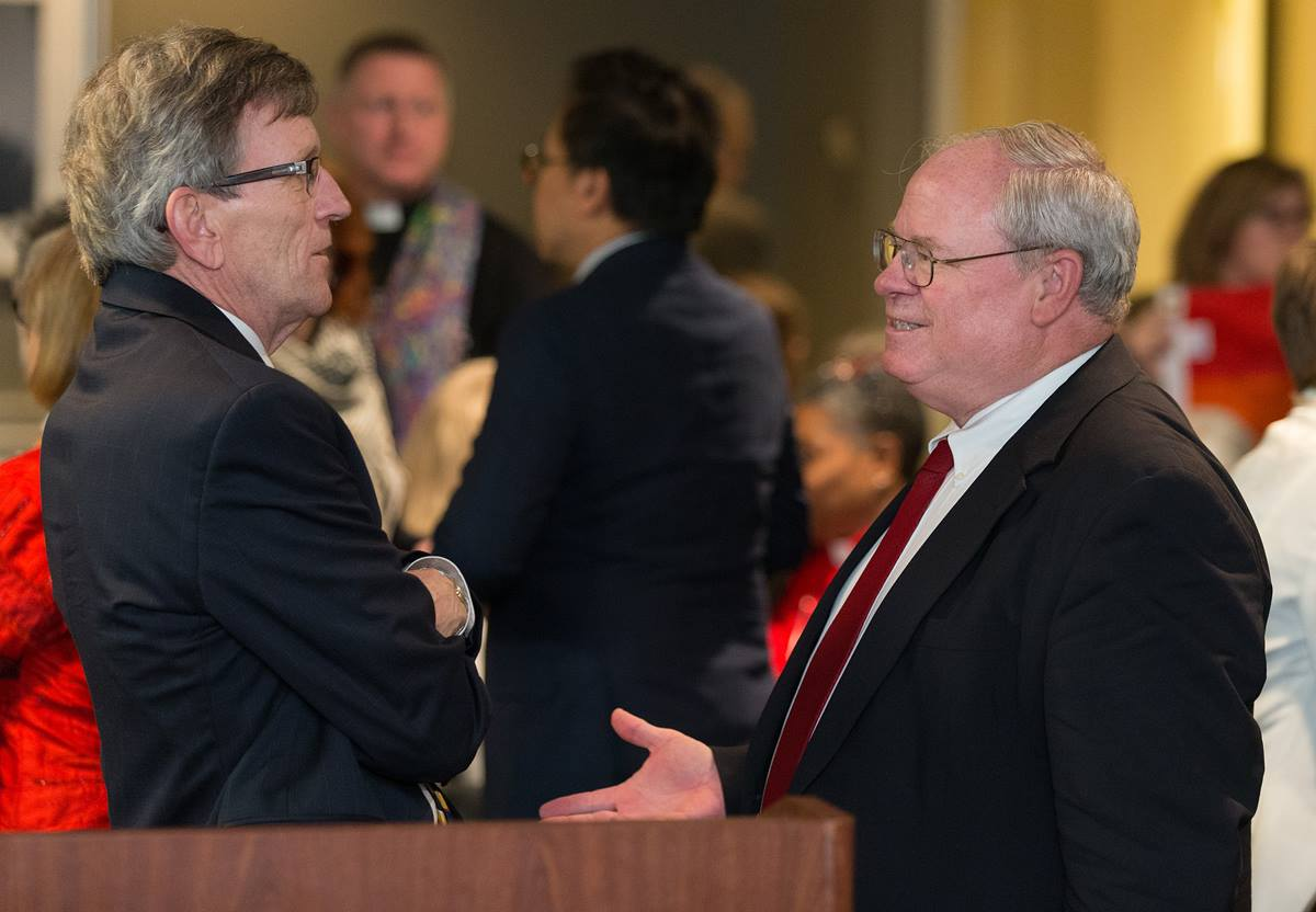 Richard A. Marsh (left) and the Rev. Keith Boyette visit one another after making oral arguments about whether a gay pastor can serve as a bishop in The United Methodist Church before the United Methodist Judicial Council, meeting in Newark, N.J., on April 25, 2017. The two argued opposite sides of the issue.