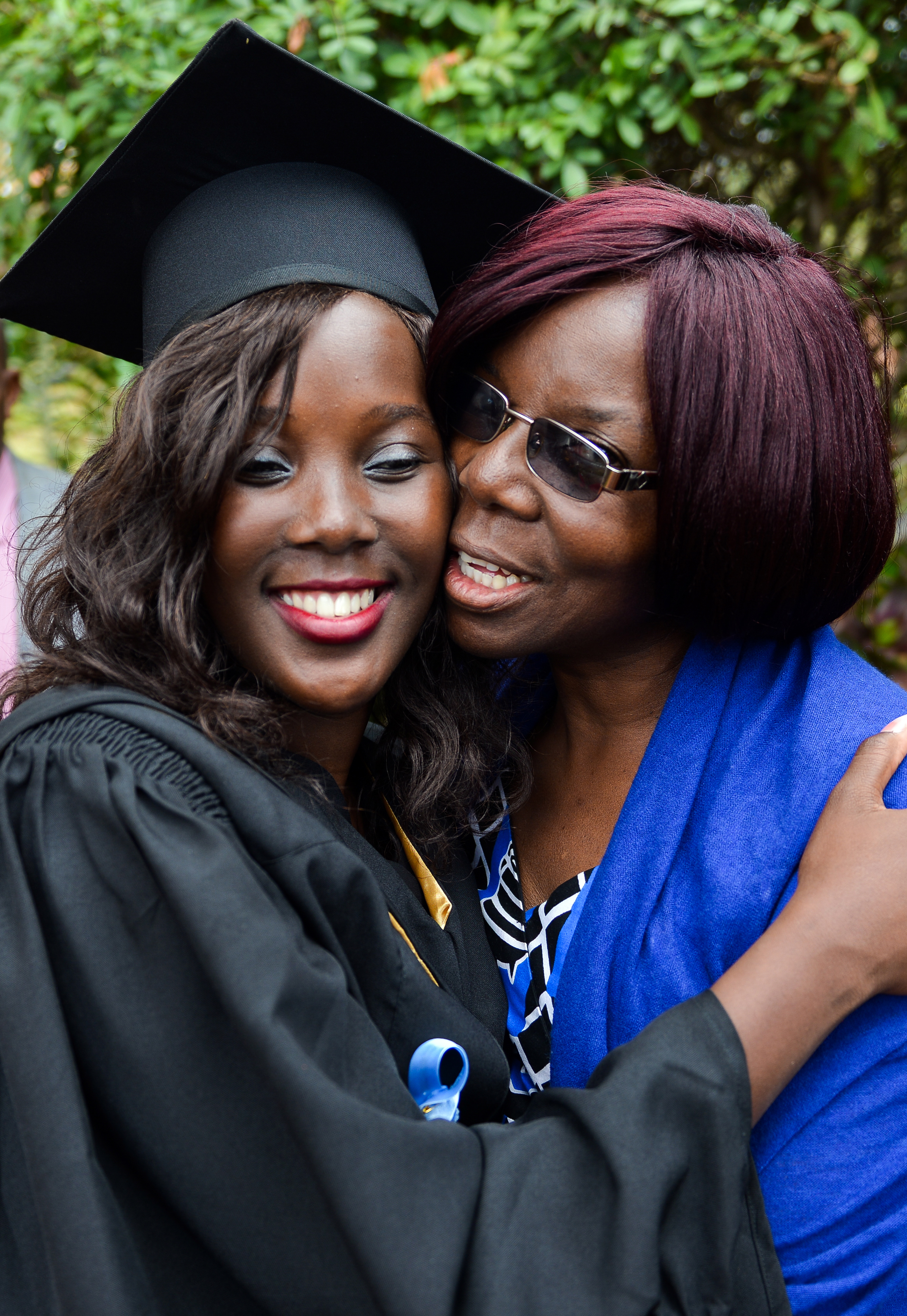 Nyasha Lynette Muropa (left) receives a hug from her mother during the 2017 commencement ceremonies at Africa University, a United Methodist school in Mutare, Zimbabwe. Muropa received a Bachelor of Accounting degree. Photo courtesy of Africa University.