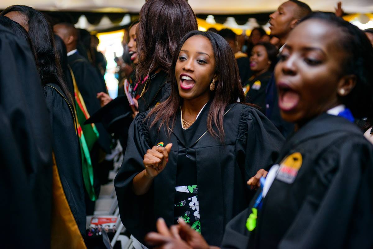 Tsungai Shalom Kaseke (center) who graduated with honors in Psychology, and Ntandoyenkosi Band (right) from the same program, give a shout of joy during their 2017 graduation ceremony at Africa University. Students from 23 African countries received degrees from the United Methodist school in Mutare, Zimbabwe. Photo courtesy of Africa University.