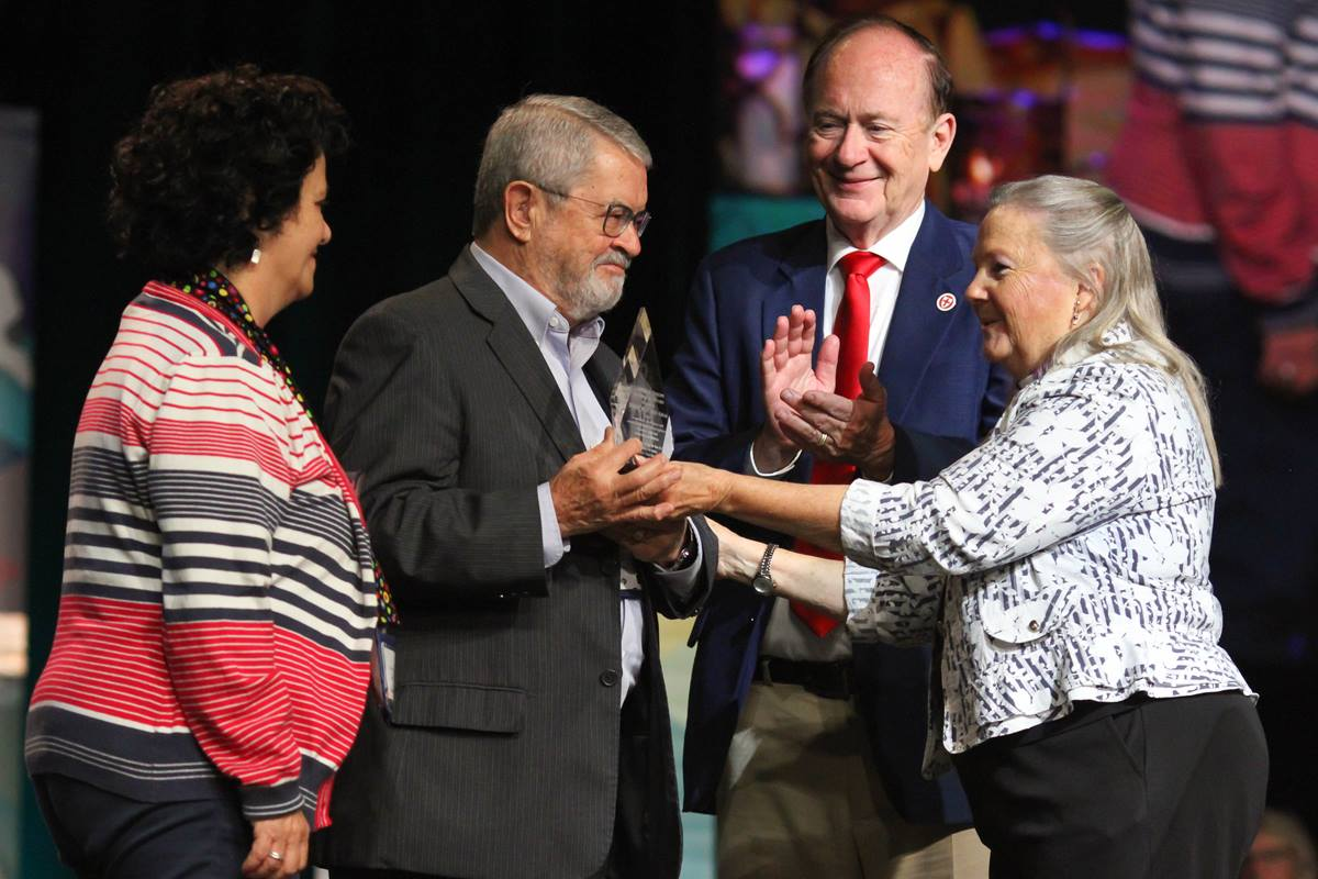 The Rev. Oscar Bolioli and Maria Cristina Ferrou accept the Council of Bishops Ecumenical Award from Bishop Mary Ann Swenson on behalf of the Rev. Mortimer Arias of Uraguay while the Rev. Don Messer applauds. The award was presented during the May 17 morning worship of the United Methodist 2016 General Conference in Portland, Ore. File photo by Maile Bradfield, UMNS.