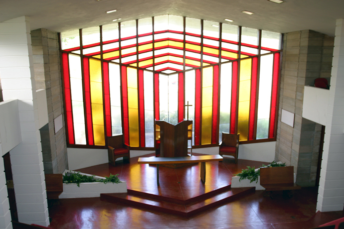 The Danforth Chapel at Florida Southern College incorporates triangular patterns and has a triangular-shaped roofline that extends out into a point more than 15 feet from the building. The chapel is one of 12 structures designed by American architect Frank Lloyd Wright for the campus in Lakeland, Florida. Photo courtesy of Florida Southern College.