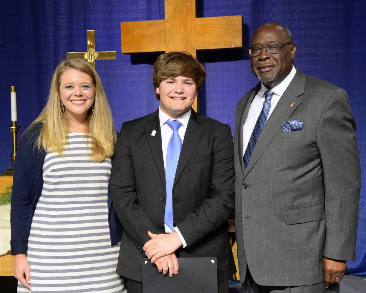 From left, Lauren Sledge, Ethan Oltremari and Bishop James Swanson Sr. stand together after Oltremari received the Mississippi Conference's Harry Denman Evangelism Award for youth. Sledge nominated Oltremari for the award for his founding of Revival on the River and his work with youth. Photo by Amanda Jefcoat.