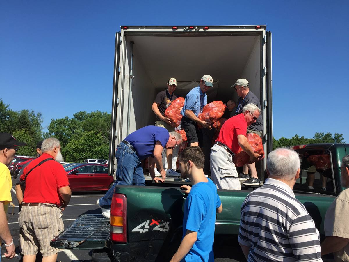 United Methodist Men unload bags of potatoes during their national gathering in Indianapolis. The potatoes will be were distributed to food banks in the Indianapolis area. The men's ministry has a partnership with the Society of St. Andrew to connect farmers and Americans dealing with hunger. Photo by Heather Hahn, UMNS.