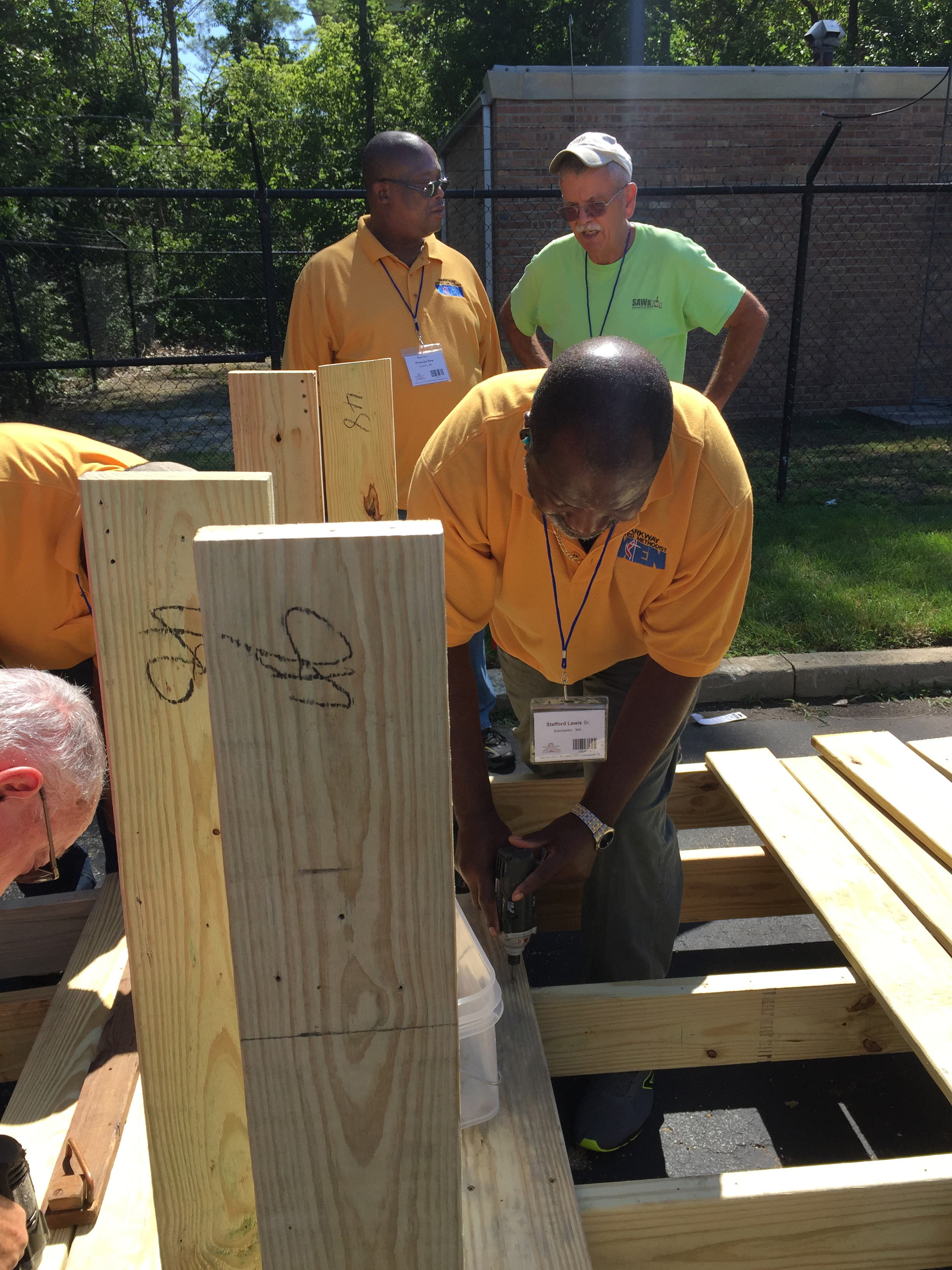 Members of United Methodist Men join with Servants at Work (SAWs), a ministry of St. Luke's United Methodist Church in Indianapolis, to construct wheelchair ramps. Many of the men involved in the project were from Parkway United Methodist Church in Milton, Mass. Photo by Heather Hahn, UMNS.