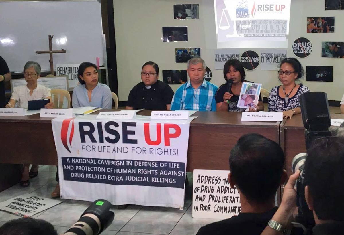 In a file photo, Norma Dollaga, right in black and white top, participates in a press conference held at the National Council of Churches in the Philippines, March 2016. Rise Up for Life and for Rights, a group dedicated to the protection of human rights against drug-related extrajudicial killings and violations in the Philippines, joined forces with the National Union of People's Lawyers-National Capital Region for the press conference. Photo courtesy of Rise Up for Rights and For Life.