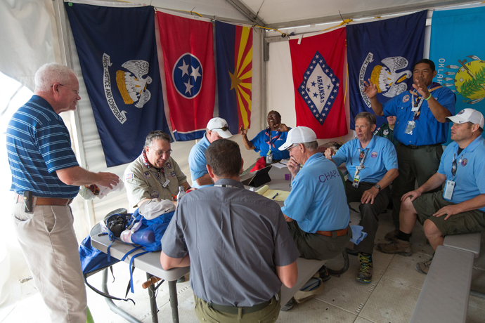 Volunteer chaplains begin their day with a staff meeting at the 2017 National Scout Jamboree at the Summit Bechtel Reserve in Glen Jean, W. Va. The United Methodist Church was the second-largest faith group represented at the event, with 3,500 professed United Methodists attending the Boy Scouts of America's quadrennial celebration July 19-28. Photo by Mike DuBose, UMNS.